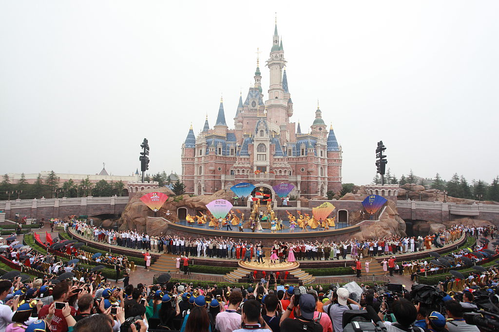 SHANGHAI, CHINA - JUNE 16: Tourists watch the opening ceremony at Shanghai Disney Resort on June 16, 2016 in Shanghai, China. Shanghai Disney Resort held the opening ceremony and welcomed tourists on Thursday. (Photo by Visual China/Getty Images)